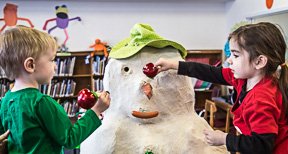 Decorating a snowman at Anderson Lee Library